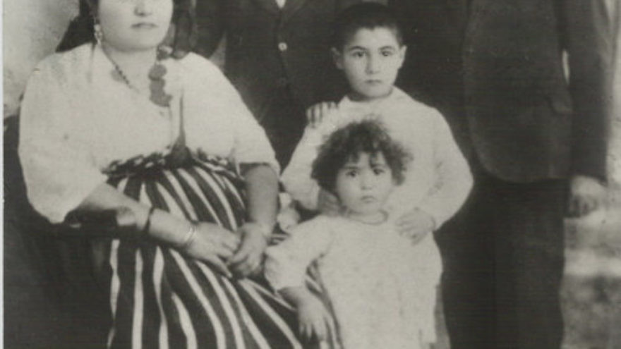 Click photo to download. Caption: Prof. Maurice Roumani's grandparents and other family members from Libya, pictured in the late 1920s. Members of Roumani's extended family in Libya endured everything from expulsions, to a 1,200-mile trek through the Saharan desert, to deportations to the Bergen-Belsen concentration camp. Credit: Courtesy Prof. Maurice Roumani.