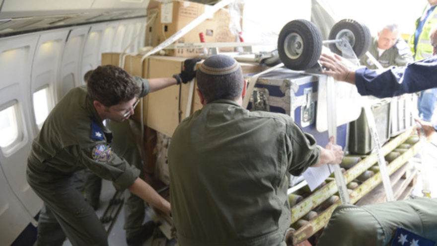 Click photo to download. Caption: On April 27, Israeli personnel load an aircraft with rescue equipment at Ben Gurion International Airport while the Israel Defense Forces aid delegation prepares to leave for its mission to Nepal in the aftermath of a deadly earthquake there. Credit: IDF Spokesperson.