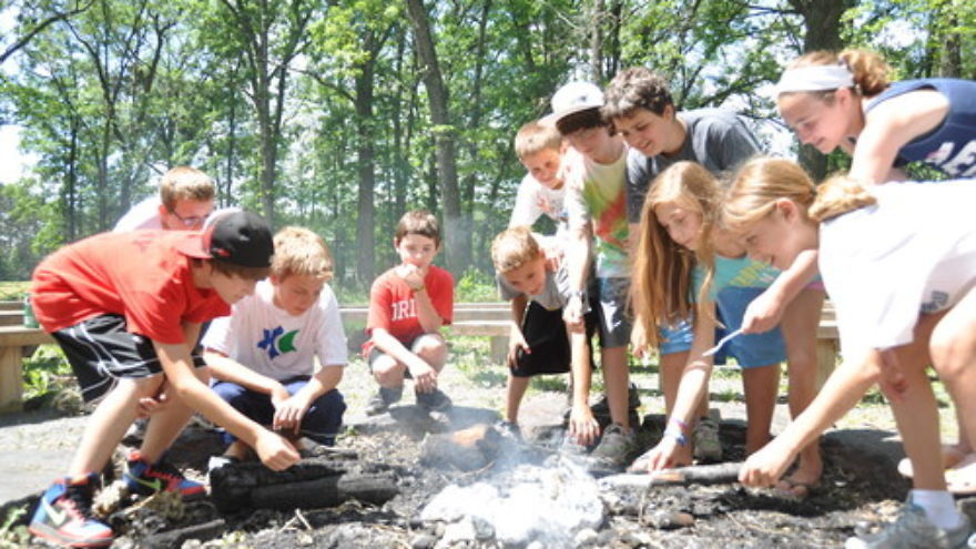 Click photo to download. Caption: A campfire at Webster, Wisconsin-based Herzl Camp, a JCamp180-supported summer camp. Credit: Herzl Camp.