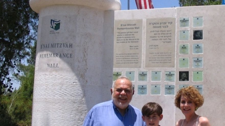 Click photo to download. Caption: Max Levin with his parents Judy and Bud in front of the B'nai Mitzvah Remembrance Wall, located in the Jerusalem hills near Beit Shemesh. Credit: Jewish National Fund.