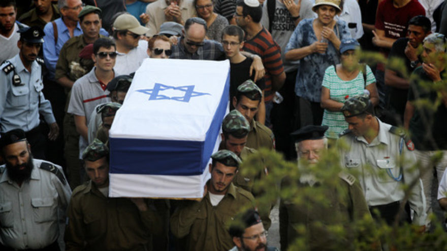Friends and relatives mourn at the funeral of IDF Sgt. Barkey Ishai Shor on Mount Herzl in Jerusalem on July 29, 2014. Shor was one of 66 Israeli soldiers killed during last summer's war with Hamas. Credit: Miriam Alster/Flash90.