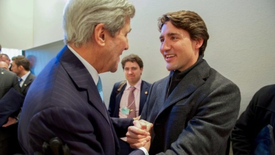 Click photo to download. Caption: Canadian Prime Minister Justin Trudeau (at right) with U.S. Secretary of State John Kerry at the World Economic Forum in Davos, Switzerland, in January 2016. Credit: U.S. State Department.