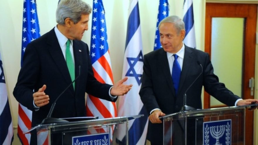 Click photo to download. Caption: U.S. Secretary of State John Kerry directs a comment to Israeli Prime Minister Benjamin Netanyahu after a meeting in Jerusalem on September 15, 2013. Credit: U.S. Department of State.