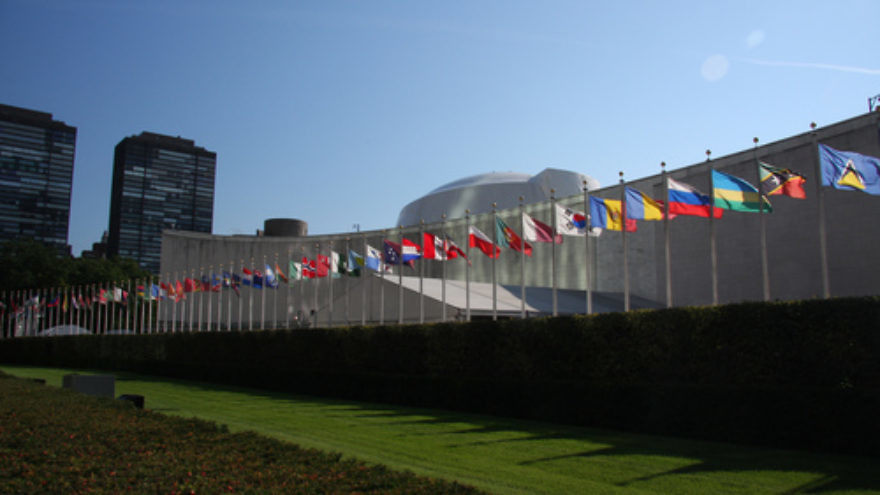 The row of flags of member countries of the United Nations in front of the U.N. General Assembly building in New York. Credit: Yerpo via Wikimedia Commons.