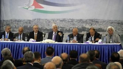 Palestinian Authority leader Mahmoud Abbas (center) attends a meeting of Palestinian businessmen in Ramallah April 29, 2014. The Palestinian National Fund, often in partnership with the P.A., pays salaries to imprisoned Palestinian terrorists and their families. Credit: Issam Rimawi/Flash90.