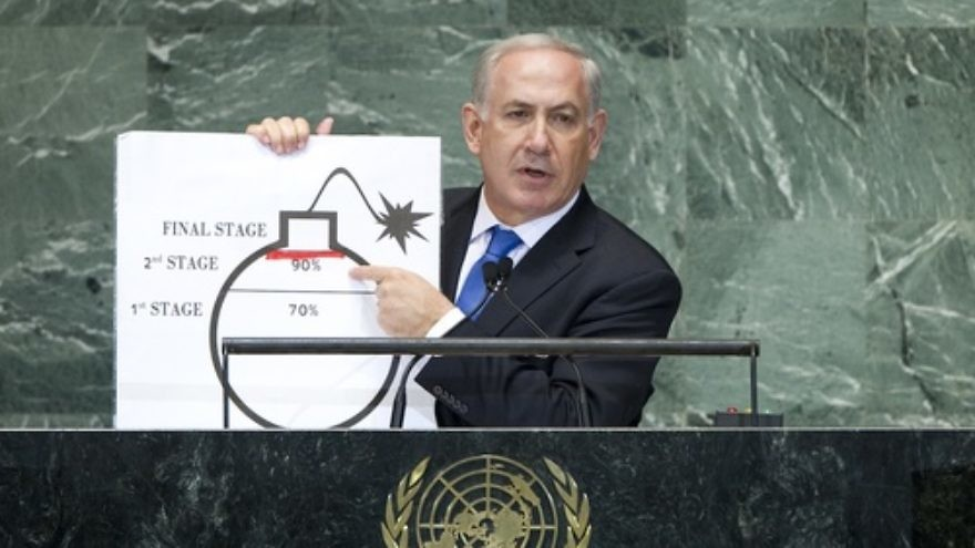 Click photo to download. Caption: Israeli Prime Minister Benjamin Netanyahu speaks at the United Nations last month, pointing to a cartoonish drawing of a bomb to illustrate Iran's nuclear development. Credit: UN Photo/J Carrier.