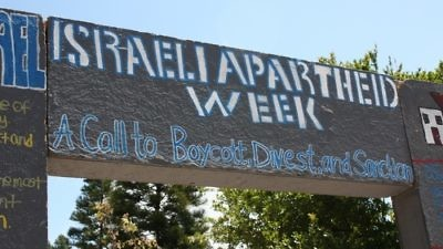 """A sign for """"Israeli Apartheid Week,"""" the annual international anti-Israel showcase, on the campus of the University of California, Irvine, in May 2010. Credit: AMCHA Initiative."""