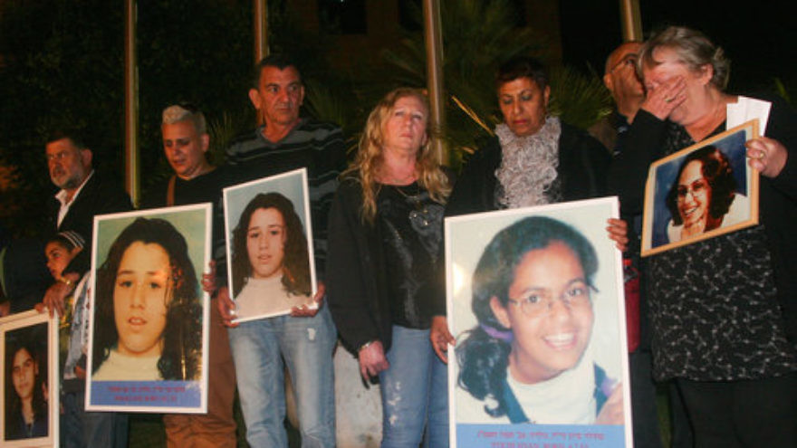 Relatives of the seven Israeli schoolgirls killed by Jordanian terrorist Ahmed Daqamseh in 1997 hold photos of the victims during a demonstration in front of the Jordanian Embassy in Ramat Gan, Israel. Credit: Flash90.