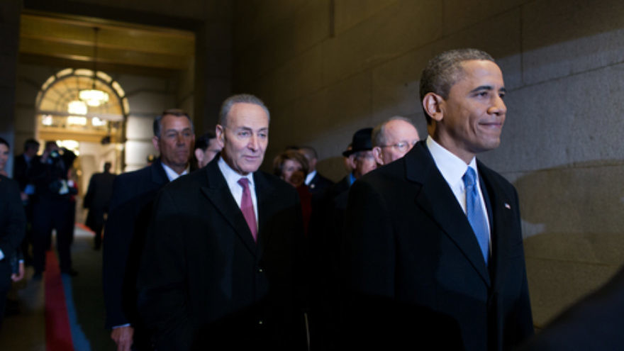 Click photo to download. Caption: U.S. Sen. Chuck Schumer (D-N.Y., pictured in center) supports a bill that would mandate Congressional review of a final nuclear deal with Iran. President Barack Obama (far right), after previously vowing to veto the bill, may now approve a modified version. Credit: Pete Souza/White House.