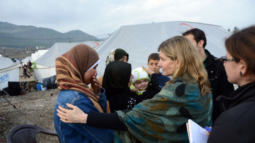 Nancy Lindborg—USAID's assistant administrator for democracy, conflict, and humanitarian assistance—interacts with Syrian refugees at the Islahiye Refugee Camp in Turkey on Jan. 24, 2013. Credit: State Department.