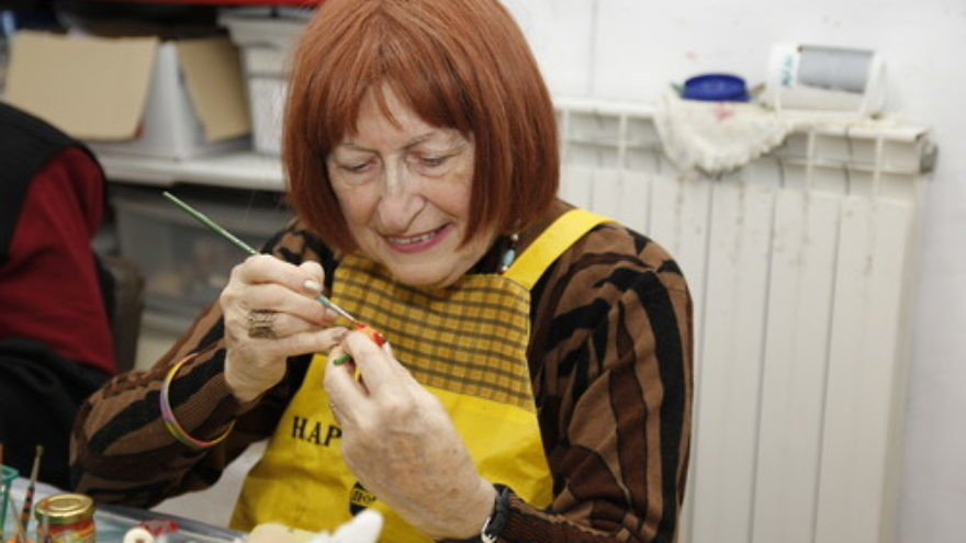 Click photo to download. Caption: Hana Kessler, 79, paints at the Lifeline for the Old facility in Jerusalem. Credit: Bonnie Geller/Lifeline for the Old.