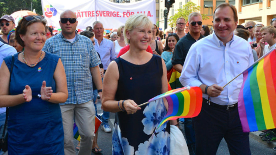 Click photo to download. Caption: Swedish Foreign Minister Margot Wallstrom (front, center) and Swedish Prime Minister Stefan Lofven (front, right)—both of whom have recently made controversial remarks on the Israeli-Palestinian conflict—march in an LGBT pride parade in Stockholm in August 2014. Credit: Frankie Fouganthin via Wikimedia Commons.