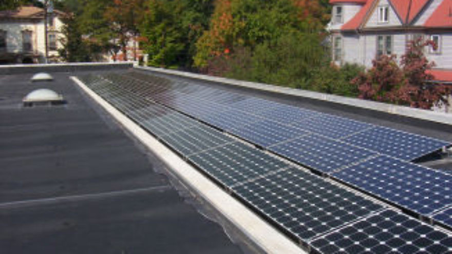 Beth El-Kesser Israel in New Haven, Conn., has a grid-tiled photovoltaic array on its synagogue roof due to the work of Rabbi Jon-Jay Tilsen and his son, Tzvi, for Tzvi's bar mitzvah project. Credit: Beth El-Kesser Israel.
