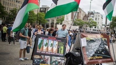 A pro-BDS display, with photos and Palestinian flags, at Dam Square in central Amsterdam June 24, 2016. Credit: Hadas Parush/Flash90.