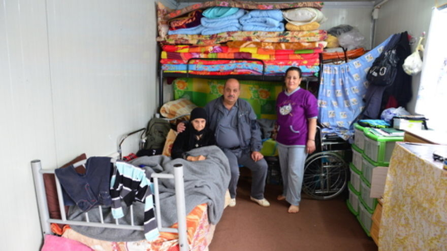 Click photo to download. Caption: Displaced Christians in cramped living conditions in Erbil, the largest city in Iraqi Kurdistan. Credit: Aid to the Church in Need.