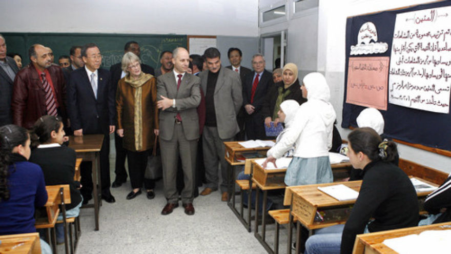 Click photo to download. Caption: U.N. Secretary-General Ban Ki-moon (second, front left) visits a Palestinian school in Bethlehem in March 2007. Credit: UN/Evan Schneider.