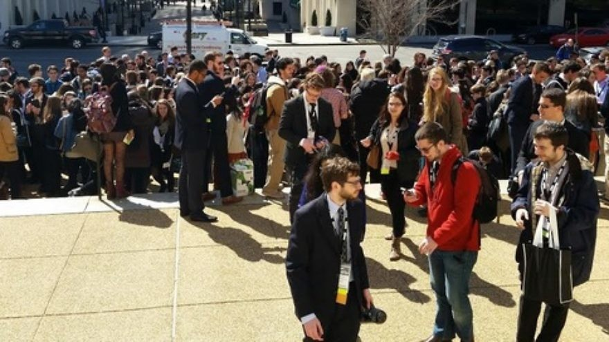 Click photo to download. Caption: J Street U students gather for a march to the Hillel International headquarters on Monday in Washington, DC. Credit: Paul Miller.