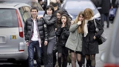 Distressed teenagers walk away from the Ozar Hatorah Jewish school in Toulouse, France, on March 19, 2012, where a man opened fire and killed a 30-year-old teacher and three young children, age 3, 6 and 10. Credit: EPA/MAXPPP/XAVIER DE FENOYL.