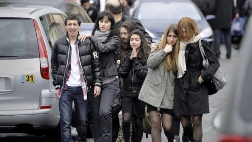 Click photo to download. Caption: Distressed teenagers walk away from the Ozar Hatorah jewish school in Toulouse, France, 19 March 2012, where a man opened fire and killed a 30-years old teacher and three children aged 6, 3 and 10. Credit: EPA/MAXPPP/XAVIER DE FENOYL.