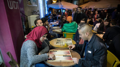 "Jews and Arabs play backgammon during the ""Jerusalem Double"" championship on Feb. 27, 2017. The competition aims to foster Jewish-Arab unity in Israel. Credit: Yonatan Sindel/Flash90."