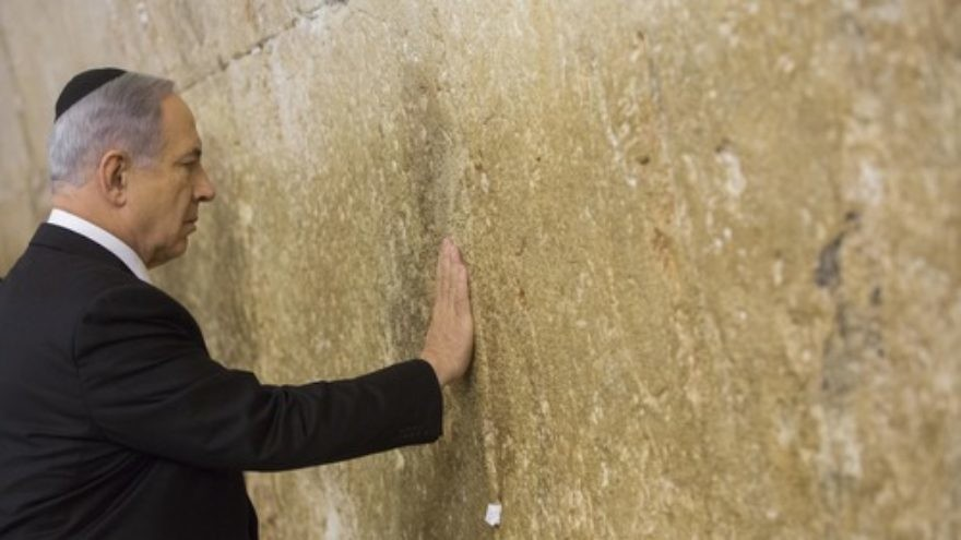 Click photo to download. Caption: Prime Minister Benjamin Netanyahu visits the Western Wall in Jerusalem's Old City on March 18, a day after the Israeli election. Credit: Yonatan Sindel/Flash90.