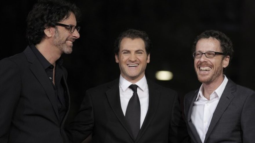 """Click photo to download. Caption: US directors and producers Joel (L) and Ethan (R) Coen pose for photographs with US actor and cast member Michael Stuhlbarg on the red carpet as they arrive at the screening of their film, """"A Serious Man"""" during the 4th annual Rome Film Festival in Rome, Italy, October 22, 2009. Credit: EPA/Guida Montani."""