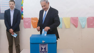 Israeli Prime Minister Benjamin Netanyahu votes in Israel's last election. Credit: Marc Israel Sellem/POOL/Flash90.