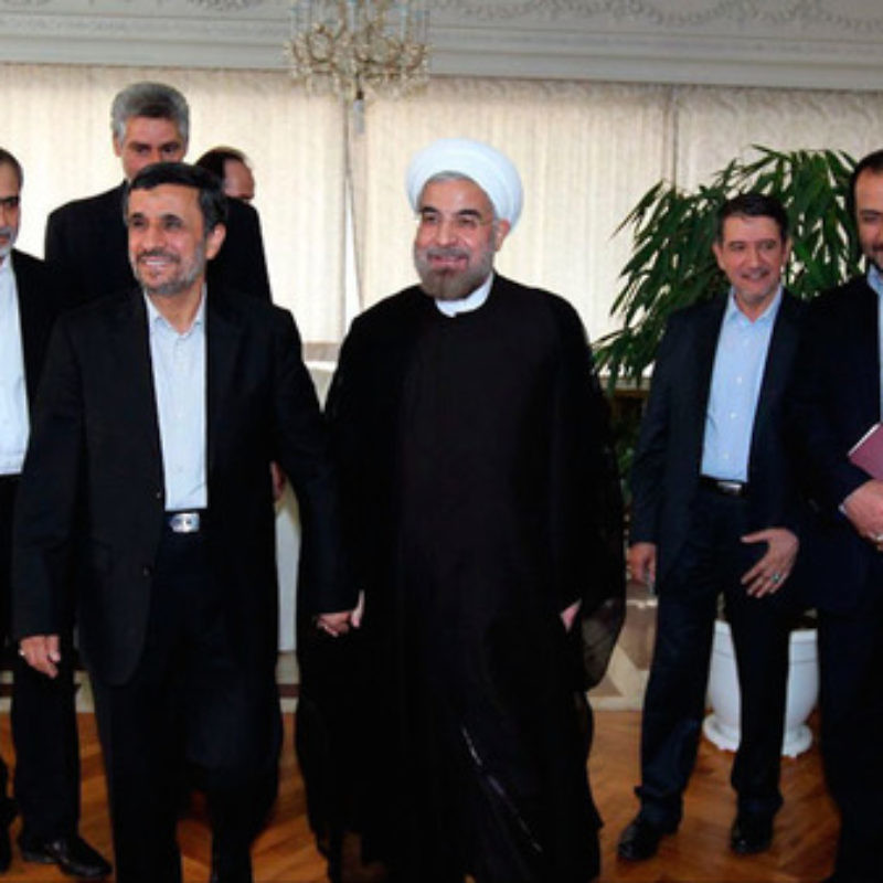 Iranian President Hassan Rouhani (center) with his predecessor, Mahmoud Ahmadinejad (second from left), in June 2013. Credit: Wikimedia Commons.