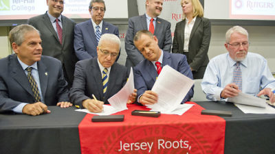 Click photo to download. Caption: On Sept. 18 at Rutgers University in New Brunswick, N.J., Member of Knesset Erel Margalit (front, third from left) and incoming Tel-Hai College president Yossi Mekori (front, second from left) sign a memo of understanding to establish the New Jersey-Israel Healthy, Functional and Medical Foods Alliance between Rutgers and Tel-Hai. Credit: Ron Sachs.