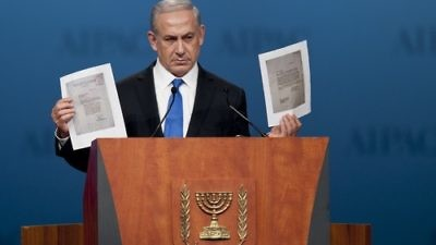 During his Monday night speech at the AIPAC policy conference, Prime Minister Benjamin Netanyahu holds up a copy of letters from 1944, in which the World Jewish Congress had implored the American government to bomb Auschwitz. Credit: EPA/PETE MAROVICH.