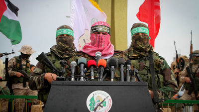 Abu Ubaida (center), a spokesman for Hamas's military wing, speaks in the southern Gaza town of Rafah on Jan. 31, 2017. Credit: Abed Rahim Khatib/Flash90.