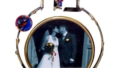 "Click photo to download. Caption: Artist Gary Rosenthal's ""Ahava"" broken wedding glass keepsake photo frame. Credit: Courtesy Gary Rosenthal."