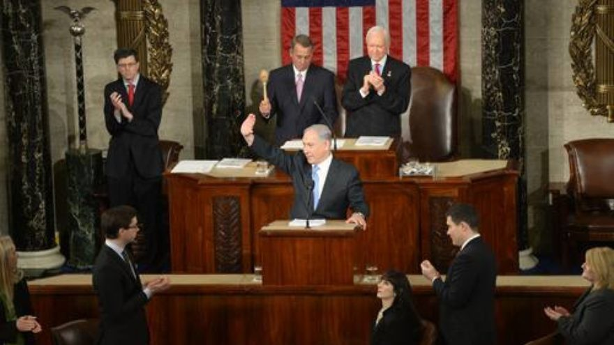 Israeli Prime Minister Benjamin Netanyahu waves to the crowd during his address to a joint session of Congress on Tuesday. Credit: Amos Ben Gershom/GPO.