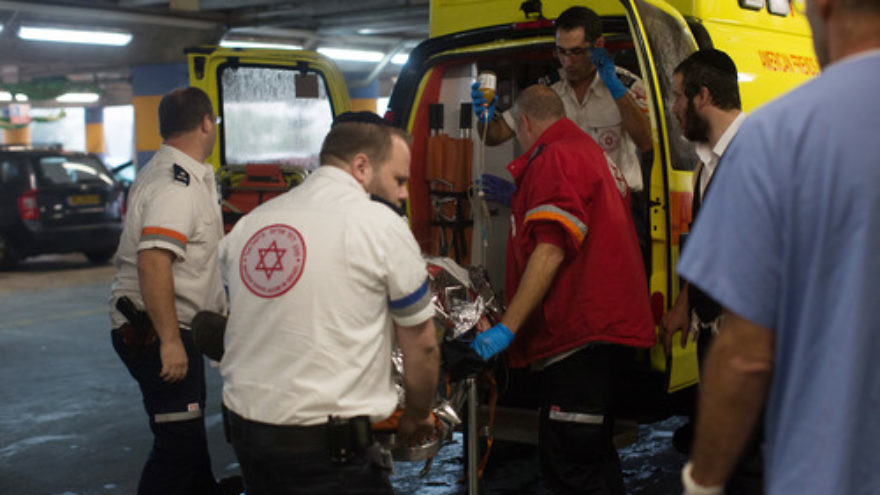 Click photo to download. Caption: Paramedics wheel a wounded Israeli man into the emergency room of the Shaare Zedek Medical Center on Nov. 6, 2015, after he was stabbed by a Palestinian attacker in the Sha'ar Binyamin industrial park in Judea and Samaria. Credit: Yonatan Sindel/Flash90.