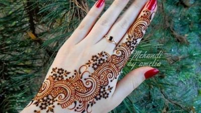"An Islamic bride's hand is decorated as part of the ""henna"" pre-wedding ritual. Credit: Courtesy Ibtisam Mahameed."