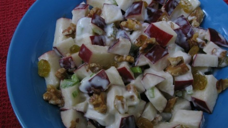 The Waldorf salad originated in the fanciest kitchen of the time, yet is a product of some of the most basic ingredients. The addition of apples is only one of many surprising ways you can include the fruit in unexpected recipes. Credit: Mollie Katzen.