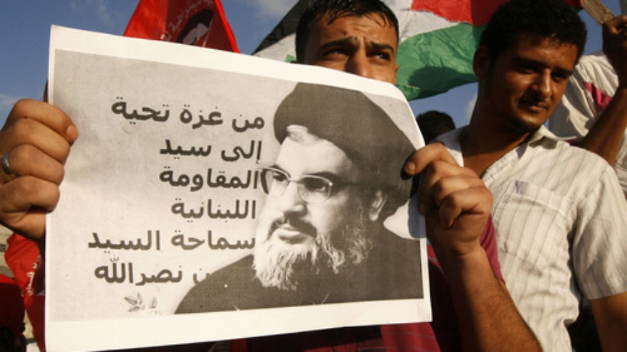 Click photo to download. Caption: During a September 2014 protest in Gaza against American and French military intervention in Syria, a Palestinian man holds a picture of Hassan Nasrallah, head of the Iranian-backed Lebanese terror group Hezbollah. Many critics of the recently reached nuclear deal fear that sanctions relief will help Iran increasingly fund terror groups like Hezbollah, Hamas, and Islamic Jihad. Credit: Abed Rahim Khatib/Flash 90.