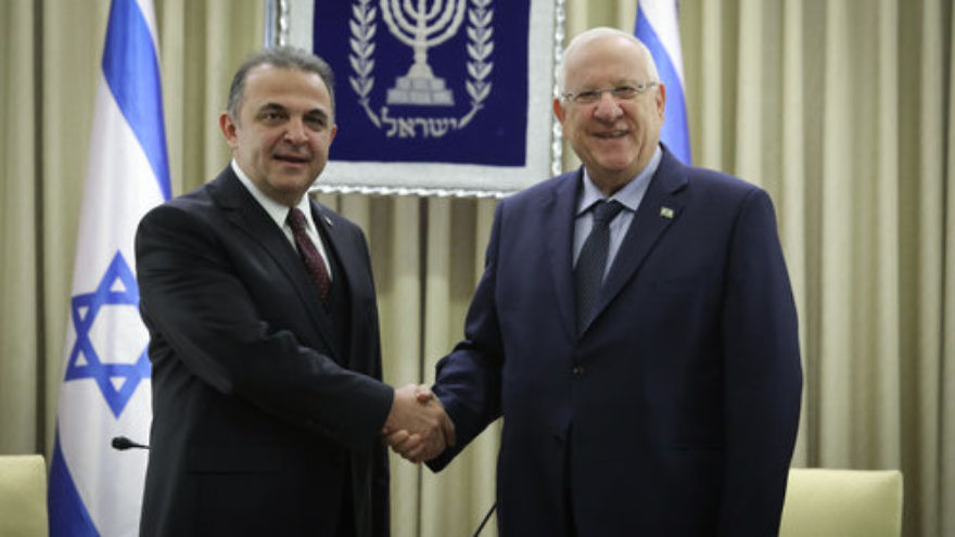 Israeli President Reuven Rivlin (right) with Kemal Okem, Turkey's first ambassador to Israel since the restoration of those countries' diplomatic relations, in Jerusalem Dec. 12, 2016. Credit: Isaac Harari/Flash90.