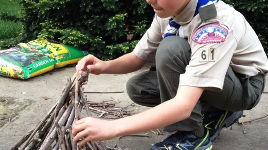 "Click photo to download. Caption: Click photo to download. Caption: Boy Scout Abraham ""Avi"" Brudoley makes a bonfire. Credit: Maayan Jaffe."