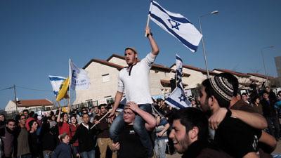 A demonstration against the planned demolition of nine homes in the Israeli settlement of Ofra Feb. 5, 2017. Credit: Tomer Neuberg/Flash90.