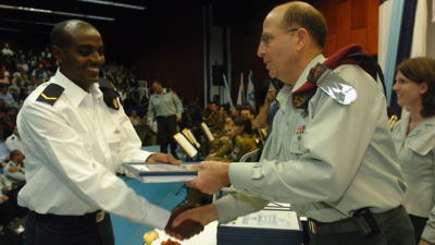 Click photo to download. Caption: Moshe Ya'alon, now Israel's vice prime minister and former IDF chief of staff, presents an award of excellence to an Israeli naval officer. Credit: IDF Spokesperon.