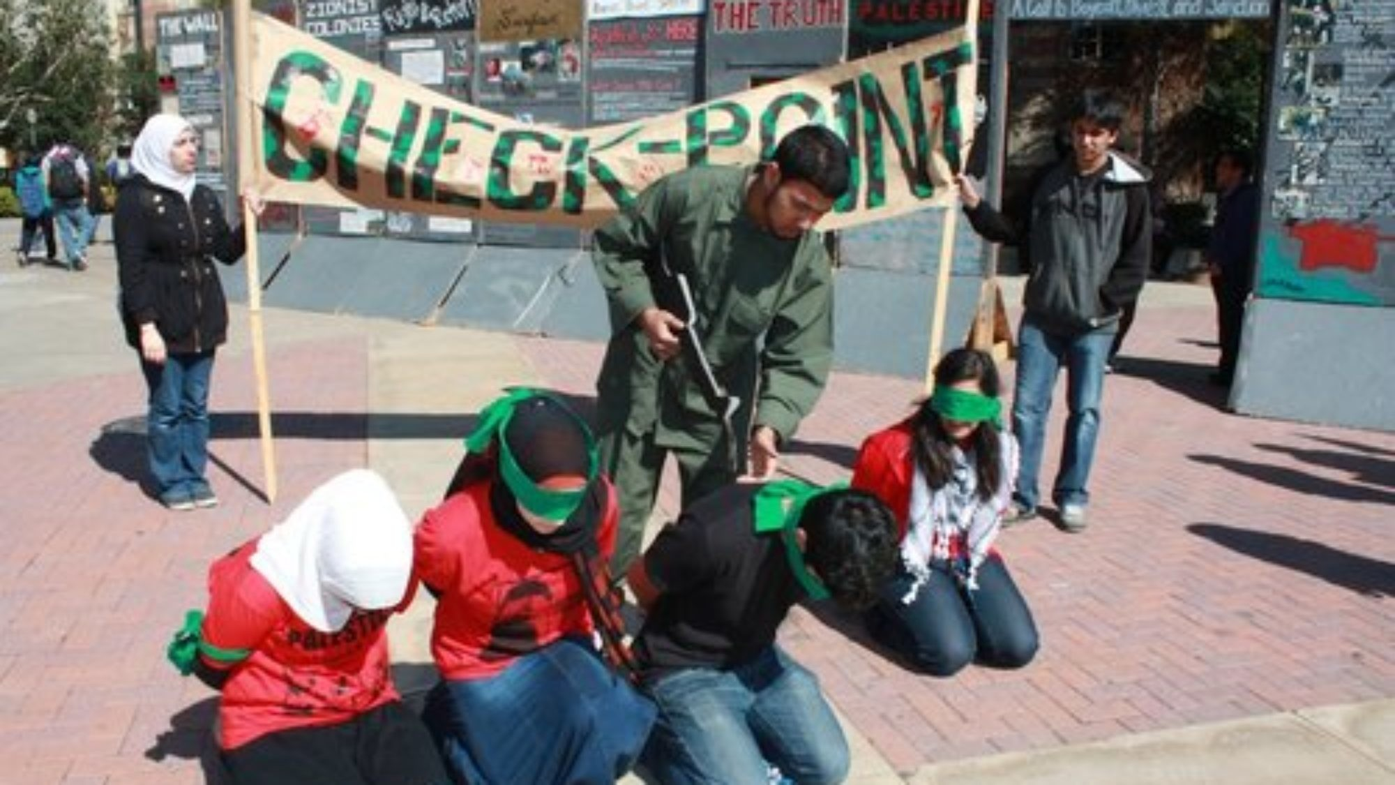 """A mock checkpoint that was set up during """"Israeli Apartheid Week,"""" an annual global anti-Israel initiative, on the University of California, Los Angeles campus. Credit: AMCHA Initiative."""