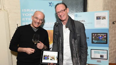 "Click photo to download. Caption: Israeli food critic Gil Hovav (left) and World Jewish Heritage Organization (WJH) founder Jack Gottlieb during the Jan. 14 launch of WJH's eBook, ""Israel's Top 100 Ethnic Restaurants,"" at New York City's Balaboosta restaurant. Credit: Shahar Azran."