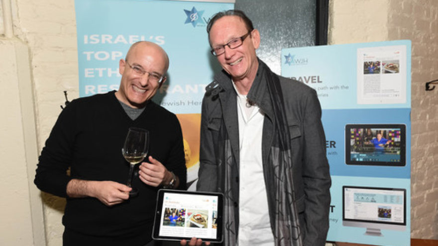 "Israeli food critic Gil Hovav (left) and World Jewish Heritage Organization (WJH) founder Jack Gottlieb during the Jan. 14 launch of WJH's eBook, ""Israel's Top 100 Ethnic Restaurants,"" at New York City's Balaboosta restaurant. Credit: Shahar Azran."