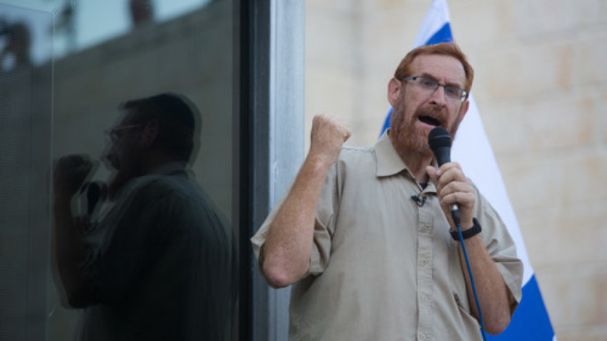 Click photo to download. Caption: Rabbi Yehudah Glick speaks during a protest outside the Temple Mount in Jerusalem on July 14, 2015, following the closing of the Temple Mount to Jews until the end of the Muslim holy month of Ramadan. Credit: Yonatan Sindel/Flash90.