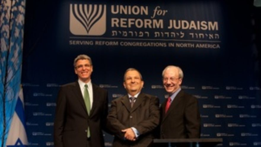 New Union for Reform Judaism President Rabbi Rick Jacobs (far left) and outgoing URJ President Rabbi Eric Yoffie flank Ehud Barak at the URJ biennial convention in Washington, DC. Credit: Courtesy Union for Reform Judaism.