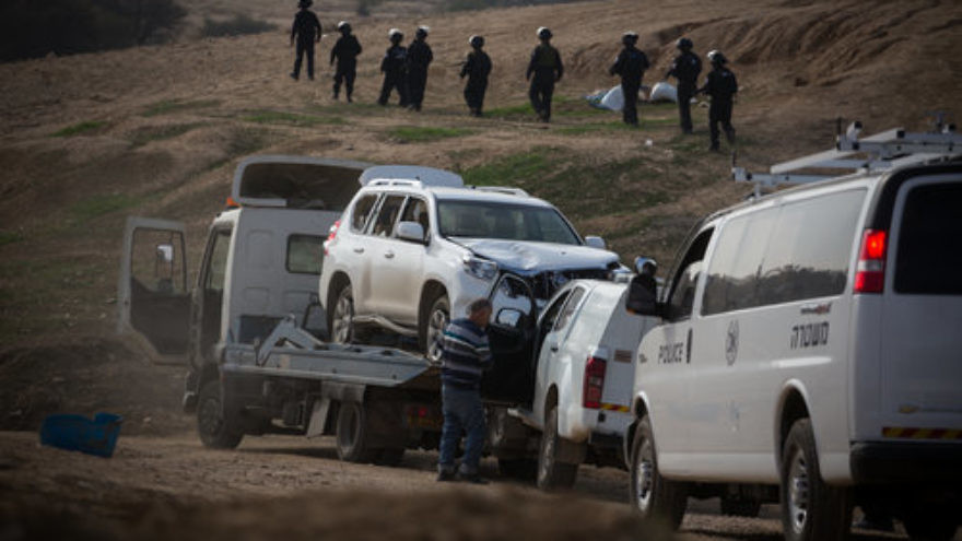 A tow truck removes the vehicle driven in the Jan. 18 car-ramming that killed Israel Police Advanced Staff Sgt. Maj. Erez Levi, 34, during protests against the demolition of the illegal Bedouin village of Umm al-Hiran. Israeli officials described the incident as a terrorist attack. Credit: Hadas Parush/Flash90.