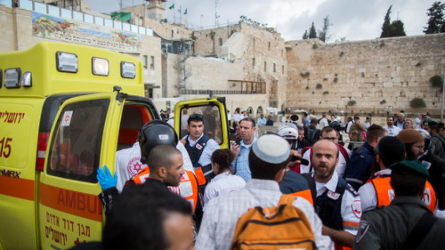 Click photo to download. Caption: Ambulances at the Western Wall evacuate injured Israelis following a terror attack in which a Palestinian woman stabbed a Jewish man near the Lions' Gate of Jerusalem's Old City on Oct. 7, 2015. Credit: Yonatan Sindel/Flash90.