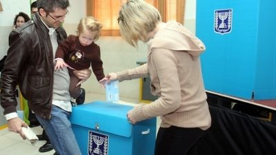 An Israeli family casts a ballot at a polling station in Tel Aviv on Feb. 10, 2009. Credit: Flash90.