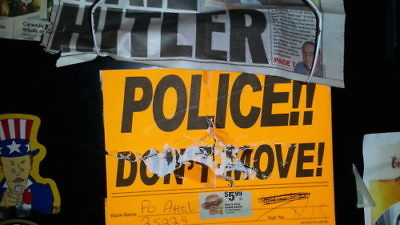 "Anti-Semitic vandalism on the locker (pictured here) of former New York Police Department officer David Attali included swastikas, the words ""dirty Jew,"" pictures of ham or bacon (which are prohibited under Jewish dietary laws), and newspaper clippings that read: ""Hail Hitler."" Credit: Courtesy."